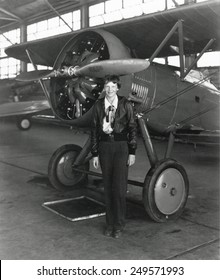 Amelia Earhart standing next to an airplane, July 30, 1936.