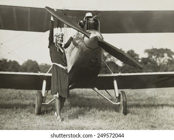 Amelia Earhart, turning the propeller of the sports plane she bought in 1928. The plane was previously owned by Mary, Lady Heath, an Irish aviatrix.