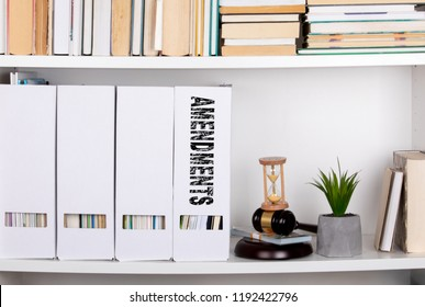 amendments concept. document folders and organizers, white book shelf