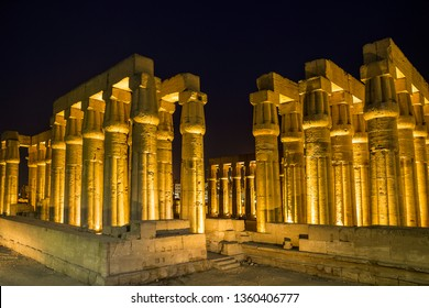 Amenhotep III colonnade lighted at night at the Luxor Temple, in the east bank of the Nile River, Luxor, Egypt