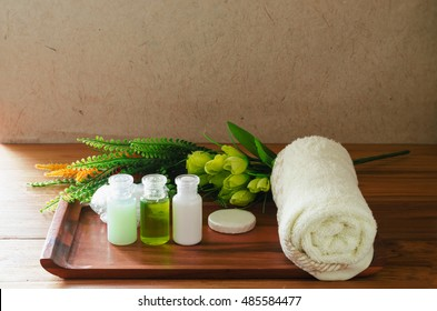 Amenity hotel, accessories for bathroom, conditioner, soap, shampoo, and towel put on wood