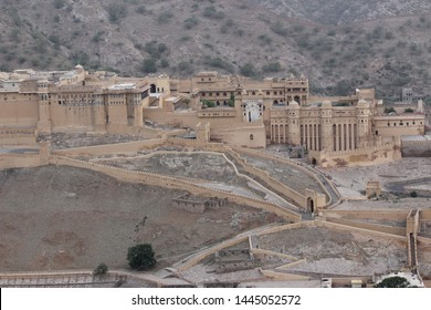 The Amer Fort Jaipur from the Amer Fort Wall. Climb up the wall to watch the sunrise and the full view of the Amer Fort in Jaipur