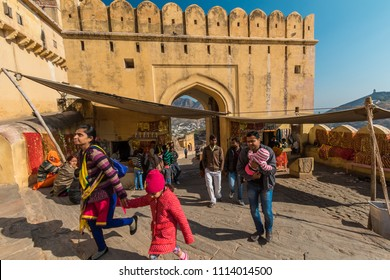 Amer, India, 12th January 2017 - Indian tourists at a gate at the Amber fort in Rajasthan, India.