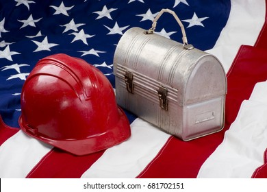 America back to work with red hard hat and flag.