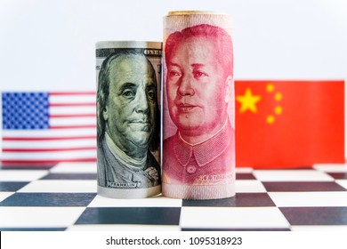 America dollar and Yuan banknote with USA and China flags. Its is symbol for tariff trade war crisis between biggest economic country in the world.