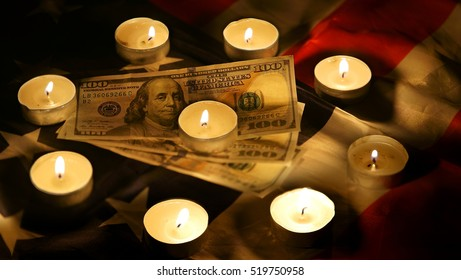 america flag and one hundred dollars by candlelight
