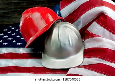 America at its greatest with flag and hard hats.