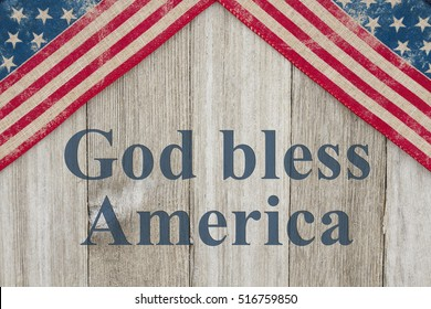 America patriotic message, USA patriotic old flag on a weathered wood background with text God Bless America