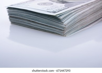 American 100 dollar banknotes on a white background