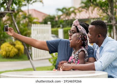 American African  black mother take mobile photo selfie family with smile and happy in garden house- American African family outdoor activity moments