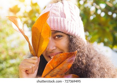 american african girl in autumn in the park