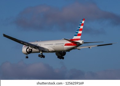 American Airlines Boeing 777-300 landing at London Heathrow International Airport in the blue sky. The aircraft registration is N717AN. London, England, UK - November 30, 2018