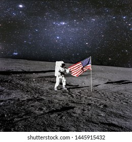 American astronaut landed and set his national flag on the planet. Spaceman explore unknown planet. Outer space. Elements of this image furnished by NASA