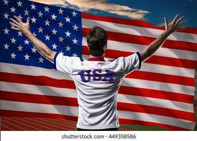 American Athlete Winning a golden medal in front of a american flag.