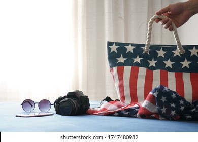 American bag in the Hotel at New York with travel accessories camera, sunglasses