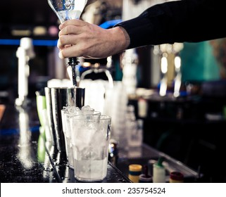american bartending calling order. bartender pouring in one tin