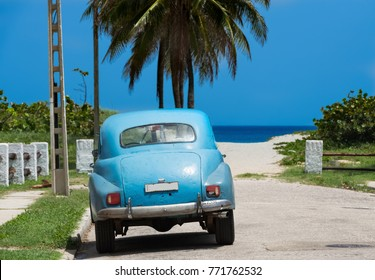 American blue classic car parked before the beach in Varadero Cuba - Serie Cuba Reportage