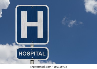 An American blue road sign with sky background with a capital H and word Hospital, Hospital Sign