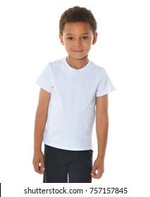 American boy in sportwear on white background. Mixed kid in white t-shirt. Handsome kids. Sporty children.