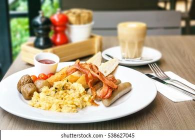 American breakfast sausage bacon scrambled eggs hash browns