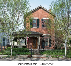 American Brick Victorian House with Birch Trees