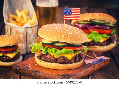 American Burger with bacon,cheese,tomato,lettuce and french fries at a Picnic for 4th of July