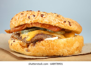 American burger on a wooden table on a neutral background