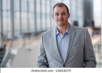 American business corporate sales person portrait in large building hall