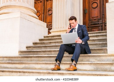 American Businessman traveling, working in New York, dressing in black suit, leather shoes, sitting on stairs outside office, working on laptop computer, calling on phone. Instagram filtered effect.