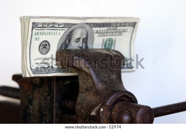 american cash held tightly in a vice with a white background