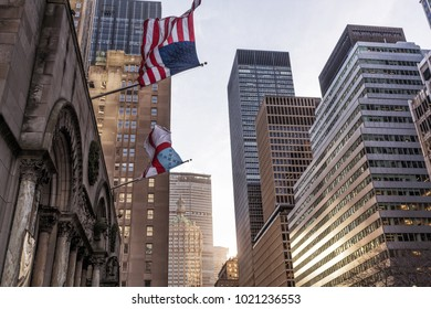 American and Christian flag, with skyscrapers in the background. New York.