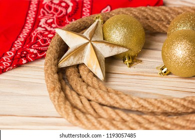 American christmas background with cowboy lasso and bandanna on wood