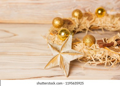 American christmas background with christmas wreath and winter holiday decoration on wood