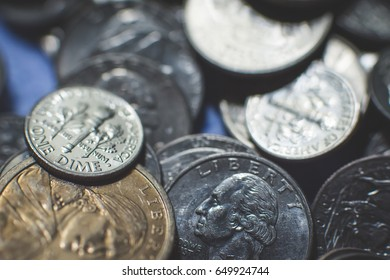 American coins background. A lot of american dollars and cents.