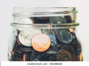 American coins in a glass jar up close - Split toned