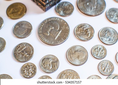 American coins. Some are old. Historical. The main currency for trade. Money is the main tool of trade in today's world. It is made of metal and paper. Many coins have a well-known figure on one side.