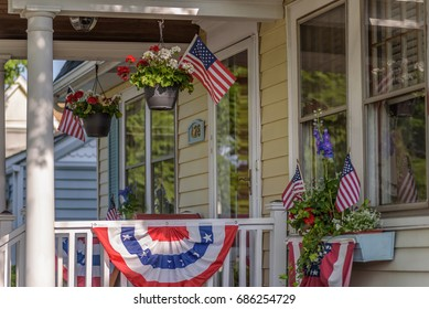 American colonial house exterior decorated for fourth of July