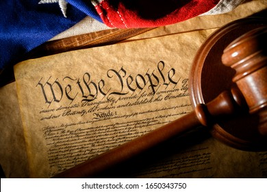 The American constitution, a gavel, and the United States flag
