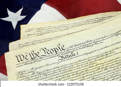 American Constitution lying over top of the US flag.
