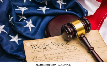 American Constitution - We the people with USA Flag and judge gavel