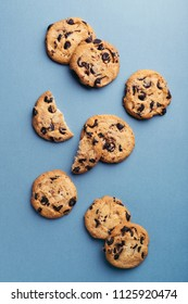 American cookies with chocolate chips on blue background. Top view.