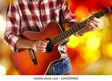 american country guitarist playing acoustic guitar live on stage