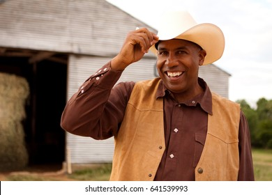 American cowboy smiling tipping his hat.