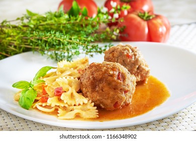 American cuisine. Pasta with meatballs and basil with sauce