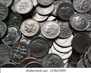 American currency coins, silver dimes, pile of money closeup