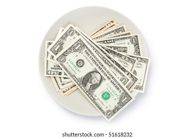 American currency on plate on white background