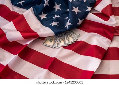 American dollar banknotes on national flag closeup