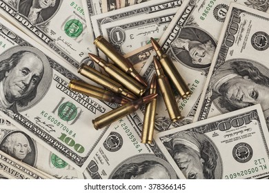 American Dollar Banknotes with Rifle  Bullets