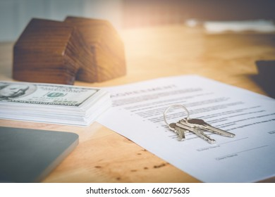 American dollar money, currency, agreement and key of home. Real estate concept