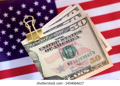 American dollar notes with the american flag.